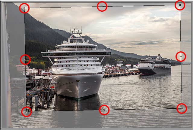 Изменение размера рамки обрезки в Camera Raw.