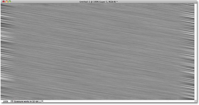 Шум теперь размыт.  Image © 2010 Photoshop Essentials.com.