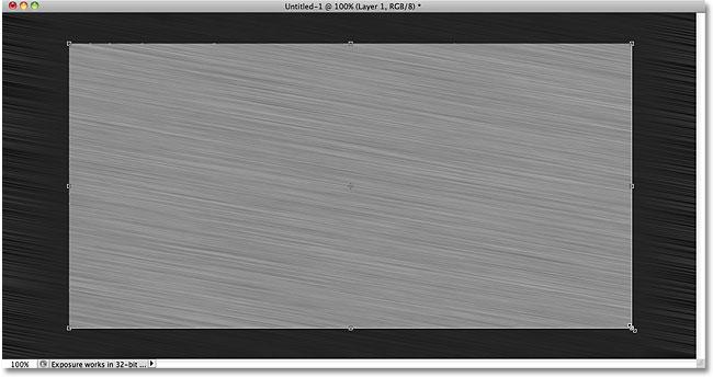 Перетаскивание выделенного фрагмента с помощью инструмента «Кадрирование».  Image © 2010 Photoshop Essentials.com.