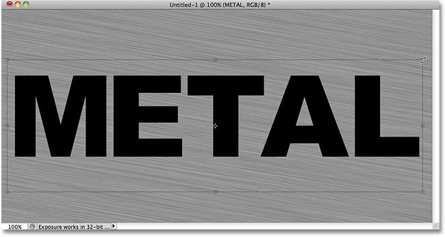 Перемещение и изменение размера текста с помощью Free Transform.  Image © 2010 Photoshop Essentials.com.