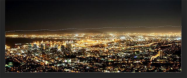 Выбор города и горного хребта с помощью инструмента Лассо в Photoshop.