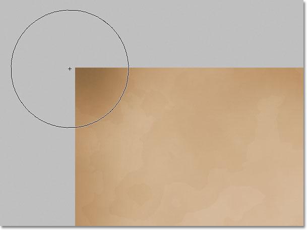 Затемнение краев бумаги с помощью Burn Tool в Photoshop.