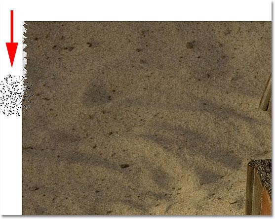 Стирание части края изображения с помощью Eraser Tool.