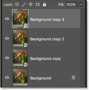 Три смарт-объекта и фоновый слой на панели «Слои»