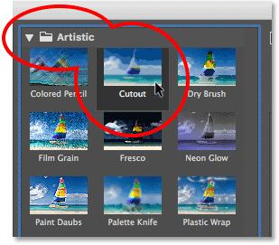 Выбор фильтра «Вырез» из категории «Художественные» в галерее фильтров.  Изображение © 2013 Photoshop Essentials.com