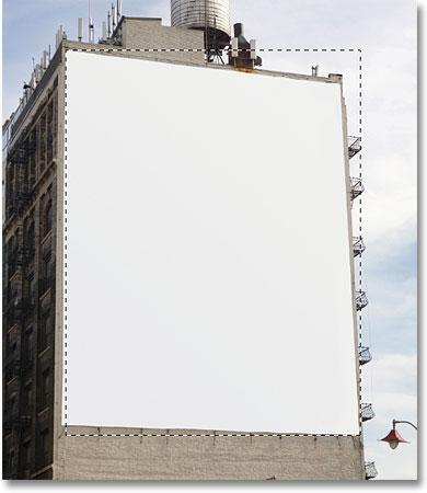 Рисование выделения с помощью инструмента «Прямоугольная область» в Photoshop.