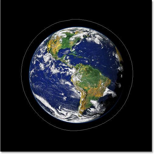 Текстовые эффекты Adobe Photoshop: теперь изображение показывает путь вокруг планеты.