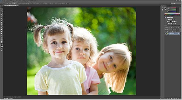 Photoshop - теперь редактор изображений по умолчанию для файлов JPEG в Windows.  Изображение © 2013 Photoshop Essentials.com