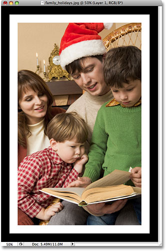 Рамка для фотографий теперь имеет как белую, так и черную рамку.  Image © 2008 Photoshop Essentials.com.